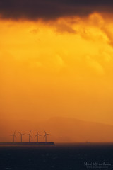 Molinos de viento de Punta Lucero (Mimadeo) Tags: ocean sunset sea sky orange mill water windmill landscape energy power wind alternativeenergy copyspace turbine alternative windturbine windfarm sustainability renewable ecological windpower windenergy renewableenergy windturbines greenenergy sustainableenergy puntalucero puntaluzero