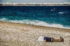 Public sleeping season begins (Melissa Maples) Tags: sleeping sea summer man beach water skyline turkey nikon asia mediterranean nap trkiye antalya lara asleep nikkor vr turk afs  18200mm  f3556g  18200mmf3556g d5100 konyaaltbeach