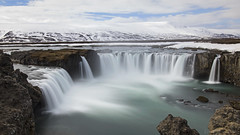 a landscape that will never let you lose ... (lunaryuna) Tags: longexposure snow ice water wow landscape waterfall iceland spring rockface le lunaryuna mountainrange godafoss snowcappedmountains waterfallofthegods seasonalchange thecolourofcold centralnorthiceland godafossstillstuckinwinter
