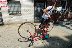 Will fixing his tire (nicknormal) Tags: bicycle helmet fixer willowen