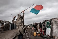 A Fight against the system. (Safidy Andrianantenaina) Tags: flag streetphotography fujifilm madagascar slum yongnuo x100t safidyandrianantenaina