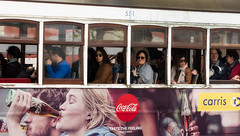 'Taste the Feeling' (Canadapt) Tags: people portugal window trolley lisbon tram tourists advertisement cocacola streetcar alfama canadapt