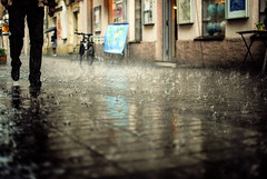 deluge (ewitsoe) Tags: storm reflection water rain 35mm walking store spring nikon fierce poland raining puddles drenched deluge poznan d80 pasaapollo bigfootcoffeeshop
