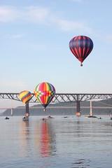 Balloons (historygradguy (jobhunting)) Tags: bridge ny newyork reflection water river three flying balloon flight upstate poughkeepsie hotairballoon hudsonriver dutchesscounty hudsonvalley walkwayoverthehudson hudsonvalleyballoonfestival itisballoon