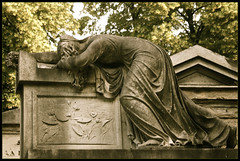 the agony of loss ... pere lachaise cemetery (ana_lee_smith) Tags: travel sculpture paris france detail macro tourism cemetery grave stone lens photography tomb photojournalism sigma ground mausoleum beercan ossuary burial columbarium f4 lachaise pre cimetire boulevarddemnilmontant analeesmith minoltaaf70210mm sonyslta33