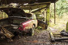 A fall from grace (2) (Colin-Powell) Tags: door roof red rot car barn cat boot rust paint flat wheels shed holes dent jaguar wreck bonnet scrap tyre xj6