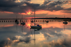 Breakthrough (Sunset Snapper) Tags: uk sunset seascape clouds reflections still nikon haylingisland peaceful hampshire calm lee nd colourful yachts filters sunrays grad southcoast breakthrough tranquil d800 waterscape langstoneharbour sunsetsnapper
