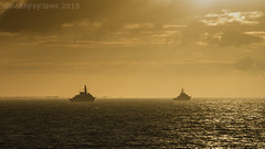At peace (Rusty Marvin - JohnWoracker.com) Tags: morning england yellow sunrise silver grey early royal isleofwight solent portsmouth middle naval warship shimmer ryde warships