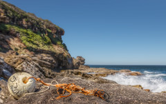 Cave Bay stray Floater (Puresilk Images (AWAY)) Tags: ocean cliff beach water rock canon bay coast cove central sigma australia nsw cave f18 18 centralcoast 1835 maitland killcare 70d kilcare bensville macmasters cavecove cavebay eos70d matland