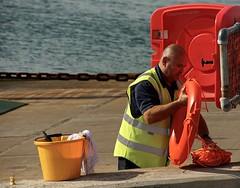 CoreWattaJob!! (Hodd1350) Tags: sea man male yellow ferry chains bucket lifebelt sony rope dorset worker sandbanks poole applecore a77 tamronlens hivisjacket