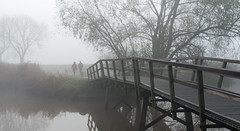 Misty morning (RuudMorijn) Tags: road park morning bridge autumn light two sky people panorama mist man cold holland reflection fall tourism dogs nature water netherlands dutch silhouette misty fog architecture river season walking landscape outside outdoors grey dawn countryside early wooden nevel scenery couple day path wandelen background infinity seasonal herfst gray foggy scenic tranquility scene explore brug toned tranquil vrouw ochtend wandeling houten noordbrabant mistig koud samen stel honden najaar sfeervol lagezwaluwe ochtendnevel schilderachtig slicesoftime blinkagain gatvandenham inspiringcreativeminds