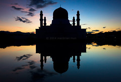 Silhouette and reflection of a mosque at Sabah, Borneo, Malaysia (Macbrian Mun) Tags: travel blue sunset sky black reflection building tower monument water beautiful silhouette architecture modern skyscraper sunrise landscape asian religious worship asia exterior place dusk background minaret muslim islam famous faith prayer religion pray praying landmark mosque structure arabic holy arab malaysia dome borneo sacred destination tall arabian sabah masjid islamic