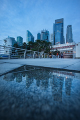 down low chillin (Jazpar) Tags: morning reflection wet architecture sunrise buildings singapore cityscapes cbd fullerton goldenlight merlionpark bluehours {vision}:{outdoor}=097 {vision}:{sky}=0651