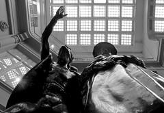 'Mephisto and Faust' (popEstatesPhotography) Tags: bw sculpture white black reflection window glass monochrome statue bronze germany deutschland mono arcade leipzig mephisto cellar goethe deutsch kellar faust auerbachs