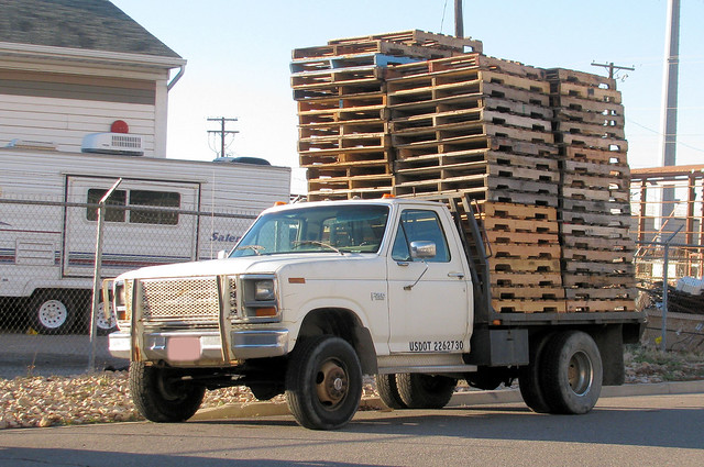 wood old classic ford truck vintage wooden rust 4x4 diesel beefy rusty pickup pickuptruck rusted oxidation vehicle pallet load pallets 1980s stacked loaded beatup beater madeinusa americanmade flatbed rustyandcrusty fourwheeldrive f350 oxidized heavyduty fomoco 1ton worktruck pushbar eyellgeteven