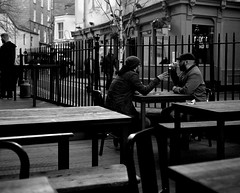 Two Lads Talking - Newcastle (Richard James Palmer) Tags: street new uk portrait england urban blackandwhite white abstract black art 120 mamiya film monochrome newcastle photography trapped shoot gloomy iso400 fineart north streetphotography documentary overcast rangefinder gritty ishootfilm tyne east iso ilfordhp5 400 walkabout epson hp5 medium format analogue melancholy northern northeast ilford f4 isolated upon newcastleupontyne 1125 80mm tyneandwear 2016 v700 mamiya7ii microphen filmisnotdead 7ii ilfordmicrophen epsonperfectionv700