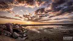 Fleetwood Beach (DugieUK) Tags: ocean light sunset sea sky cloud sun beach water skyline clouds landscape golden coast seaside sand rocks outdoor lancashire shore hour defences fleetwood