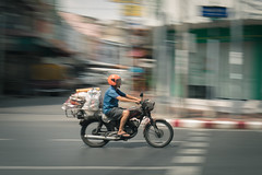 Riding in fast (jack-sooksan) Tags: road street man blur speed work thailand ride bangkok fast move thai delivery worker motocycle motobike