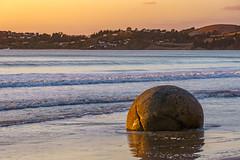 Boulder (Arief Rasa) Tags: morning sea newzealand seascape reflection beach water rock stone sunrise landscape surf outdoor wave boulders nz rockybeach moerakiboulders moeraki wetsand