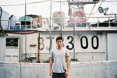 () Tags: film fuji fujifilm fujicolor 400    minolta himatic af guy man boat bay sea ocean coast port harbor portrait nanfangao