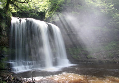 Sun Beams (Raphooey) Tags: park uk trees sun mist mountain mountains tree water rock fog wales canon river eos waterfall rocks country beam national waterfalls rivers gb limestone brecon beacons shafts sunbeam beams shaft sunbeams yr eira sgwd sgwdyreira 70d sandstonespray