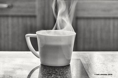 ...needed, but no biscuit ? (bob.wheater) Tags: light shadow white cup coffee tea smoke steam biscuit