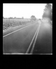 road bleed (the fencepost) Tags: road blackandwhite oregon centraloregon sx70 bend lightleak instant sonar impossibleproject