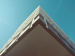 Workplace (oruwu) Tags: cameraphone sky building up corner concrete phone diagonal edge sanmateo nexus overhang cantilever