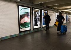 Not Shot on iPhone 6 (UrbanphotoZ) Tags: nyc newyorkcity woman ny newyork apple face leaves silhouette subway child hand manhattan headscarf passengers midtown timessquare posters westside passageway peering rollingsuitcase shotoniphone6