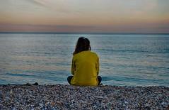 Horizon (mnika4) Tags: ocean blue sunset sea sky sun reflection beach water yellow clouds evening model focus waves stones horizon dramatic pebbles devon jumper seaton