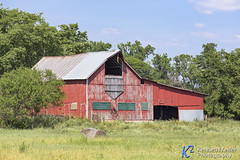 Weathered Red Barn (Kenneth Keifer) Tags: wood old blue ohio red sky building field clouds barn rural vintage landscape countryside wooden midwest colorful paint unitedstates antique farm country rustic meadow faded pasture worn weathered rolls hay agriculture bales tinroof agricultural madisoncounty hayloft lightningrods hayhood