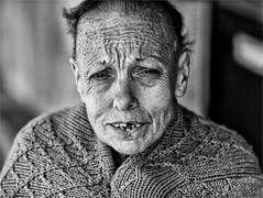 Poor old woman in Porto (zilverbat.) Tags: poverty portrait people blackandwhite bw woman portugal monochrome face photography dof image bokeh oldwoman portret oldage peopleinthecity blackwhitephotos zwartwitfotografie zilverbat