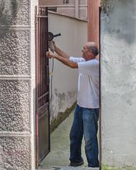174/365 (goran1101) Tags: street city people work 35mm nikon framed candid working frame nikkor oldguy d5100
