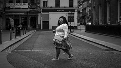 Crossing (Leanne Boulton) Tags: life road street city uk light shadow portrait people urban blackandwhite bw woman white black detail texture coffee monochrome face female canon walking mono scotland living blackwhite eyecontact crossing natural humanity outdoor expression glasgow candid widescreen culture streetphotography streetlife scene human shade crop 7d isolation form posture gesture shape cinematic society depth tone facial candidstreetphotography