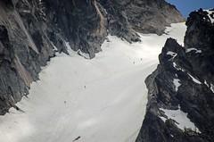 Hikers headed up Colchuck Glacier (nnylyssim) Tags: colchuck lake backpacking hiking washington aasgard pass