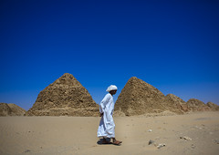 Sudanese Man In Front Of  The Royal Pyramids Of Napata, Nuri, Sudan (Eric Lafforgue) Tags: africa travel blue sky men history archaeology cemetery rock horizontal landscape outdoors temple photography sand ancient day desert pyramid northafrica soedan sudan sunny bluesky unescoworldheritagesite copyspace turban nuri ancientcivilization nubia thepast position adultsonly necropolis oneperson ruined soudan rockformation tranquilscene saharadesert northernafrica traditionalclothing realpeople traveldestinations colorimage famousplace jalabiya fulllenght oldruin onemanonly unrecognisableperson aridclimate  matureman 1people egyptianculture physicalgeography szudn napata sudo  northernsudan placeofburial northsudan blackpharaohs      xuan eri7477