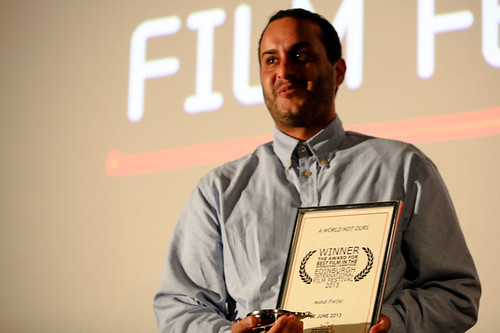 Director Mahdi Fleifel receiving the Award for Best Film In The International Competition for his film A World Not Ours