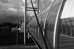 On the outside (and the moon rose) Tags: city bridge urban blackandwhite london station architecture poplar footbridge docklands dlr docklandslightrailway poplardlrstation dlrstation