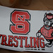 Stickers were given out to people who were curious about the wrestlig practice.