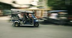 tuk-tuk (desomnis) Tags: street travel canon thailand 350d movement asia southeastasia transport streetphotography transportation canon350d tuktuk chiangmai traveling panning canoneos350d eos350d autorickshaw streetshot travelphotography