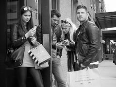 beautiful people (omoo) Tags: newyorkcity bw shopping westvillage couples streetscene communication messages beautifulpeople leatherjacket greenwichvillage sephora meatpacking girlsandboys bwphotograph twittering dscn8126 west13thandninthavenue allsaintsspitalfields girlswithcellphones blacklycrapants