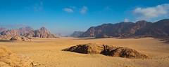 On Burdah rock, in Wadi Rum, Jordan (Miche & Jon Rousell) Tags: blue red sky cloud yellow sand rocks desert wadirum cliffs jordan sanddune rockbridge burdah burdahrockbridge