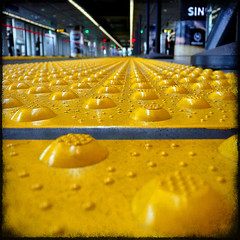 SIN (1crzqbn) Tags: color macro texture reflections square bokeh sfo bart sin hss 1crzqbn sliderssunday yesithrewmyselfonthefloor