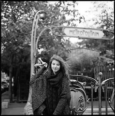 (Olivier Courtois) Tags: street portrait urban blackandwhite bw woman paris france 120 6x6 film girl monochrome zeiss square photography kodak tmax young hasselblad 400 medium format metropolitain planar 80mm 500cm classicblackwhite vision:people=099 vision:face=099 vision:outdoor=0952 vision:sky=0707