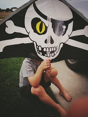 Kite-Head the Pirate ([ the black star ]) Tags: playing silly outside kingston pirate p kit skullcrossbones tipofoneofmyfingers becausethatisthekindofstellarphotographeriam
