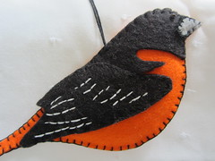Hand-Embroidered Oriole (Pictures by Ann) Tags: christmas orange baby moon white black tree bird art by project toy diy toddler colorful play hand handmade embroidery waldorf creative harvest craft felt ornament gift stitching etsy comfort imaginary stitched embroidered handwork comforting woolfelt oriole handstitching yearround handembroidered birdlover harvestmoonbyhand