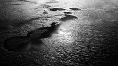 reverse archipelago [EXPLORE 2016-05-12] (pix-4-2-day) Tags: sea white black reflection monochrome puddle bottom north monochrom nordsee reflexion mudflats watt archipelago gegenlicht pftze seabed schwarzweis riffel meeresboden inselgruppe