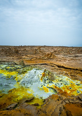 The colorful volcanic landscape of dallol in the danakil depression, Afar region, Dallol, Ethiopia (Eric Lafforgue) Tags: africa travel lake color tourism nature pool beauty vertical landscape outdoors volcano spring colorful solitude day desert natural earth acid horizon surreal nobody nopeople formation serenity heat minerals environment sulphur isolation geography geology ethiopia hotspring volcanic saline geothermal interest arid ecosystem hornofafrica afar eastafrica geological abyssinia afarregion dallol danakildepression ethio161888