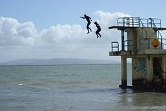Jump. (mcginley2012) Tags: sea people signs sport fun graffiti coast jump salthill steps diving railings active wetsuits blackrock divingboard galwaybay