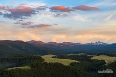 Black Tooth Mountain Sunset (kevin-palmer) Tags: bighornmountains wyoming july summer nikond750 tamron2470mmf28 bighornnationalforsest camping littlegoosecanyon evening sunset blacktoothmountain pasture meadow green grass orange red color colorful clouds trees forest snowcapped
